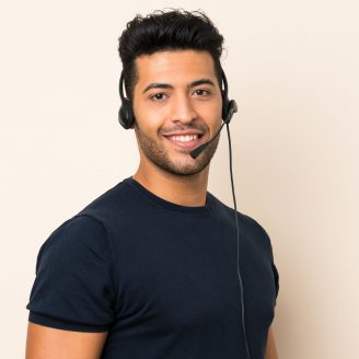 Young handsome man over isolated background working with headset